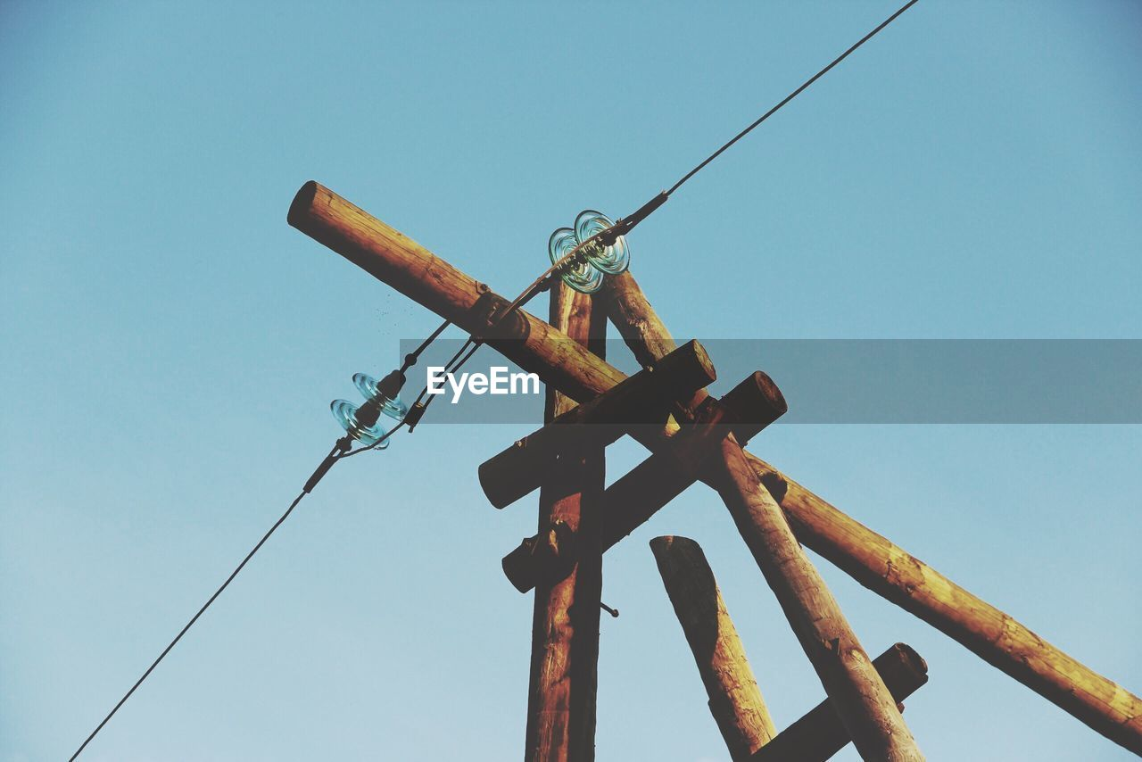 low angle view, clear sky, day, safety, blue, no people, cable, outdoors, technology, signal, close-up, sky