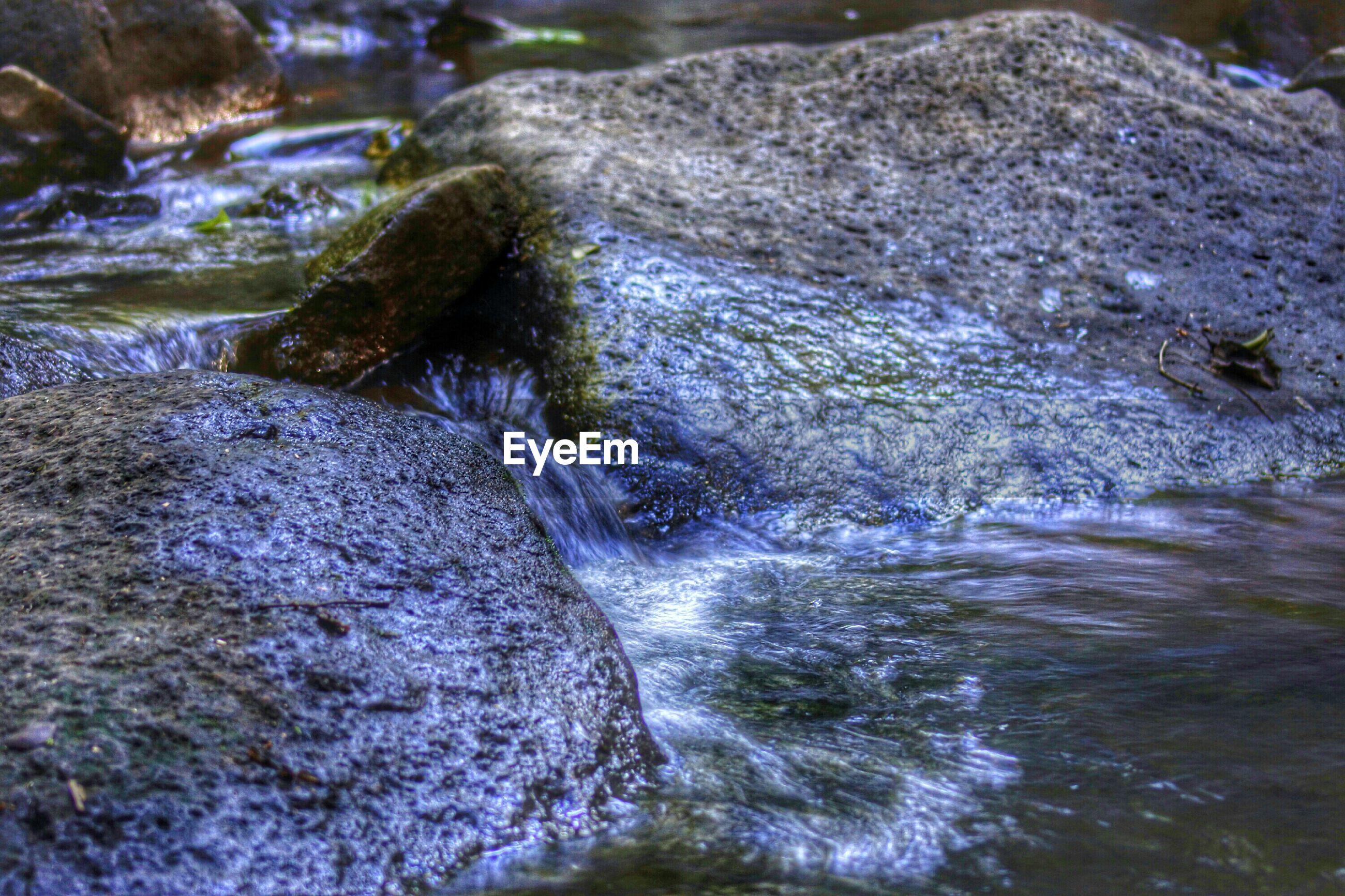 water, motion, rock - object, flowing water, waterfront, nature, beauty in nature, flowing, surf, high angle view, splashing, stream, rock formation, river, sea, waterfall, rippled, rock, day, scenics