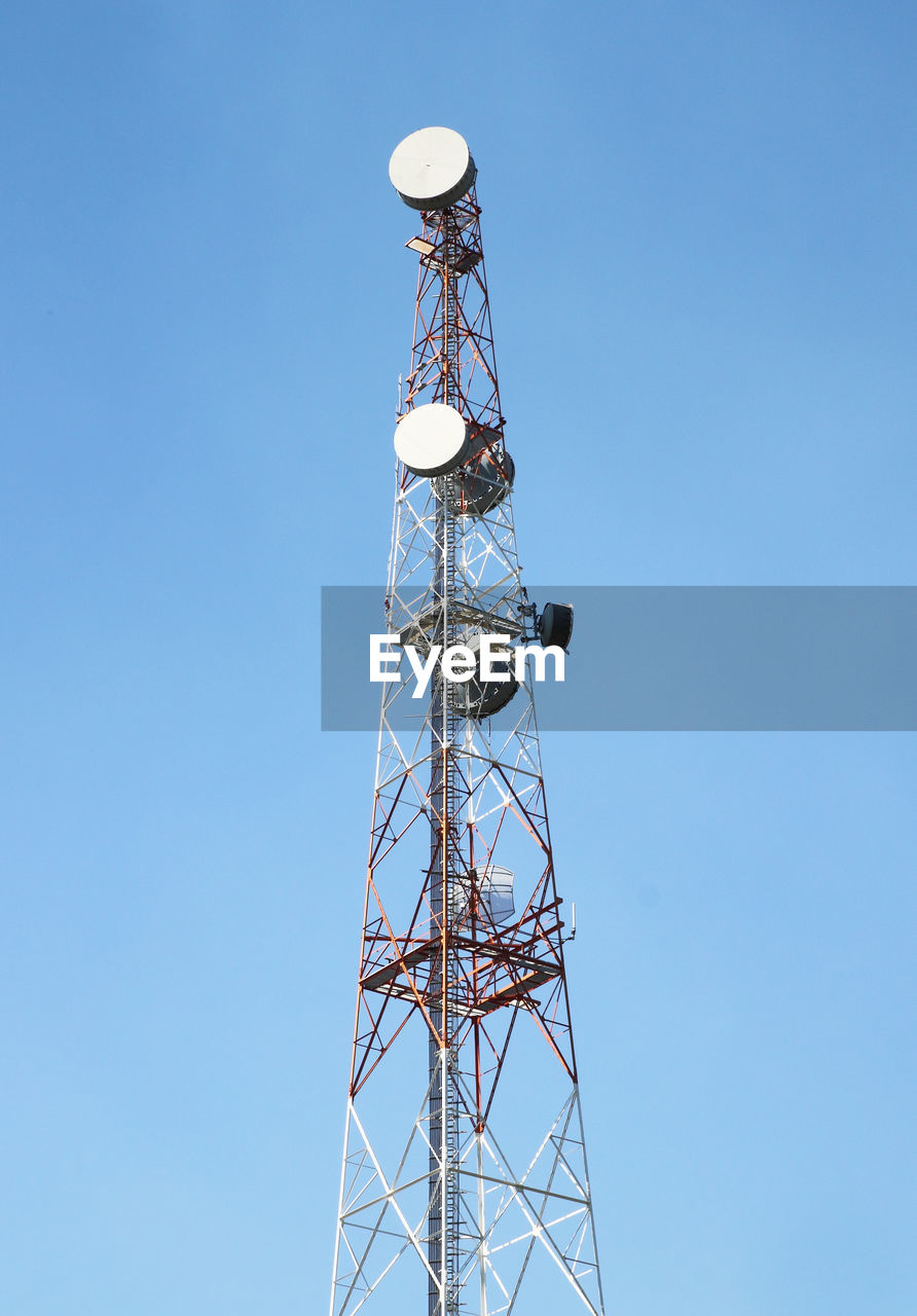 technology, tower, sky, communication, broadcasting, global communications, low angle view, connection, built structure, clear sky, satellite, nature, tall - high, architecture, wireless technology, no people, telecommunications equipment, antenna - aerial, satellite dish, outdoors, power supply, electrical equipment