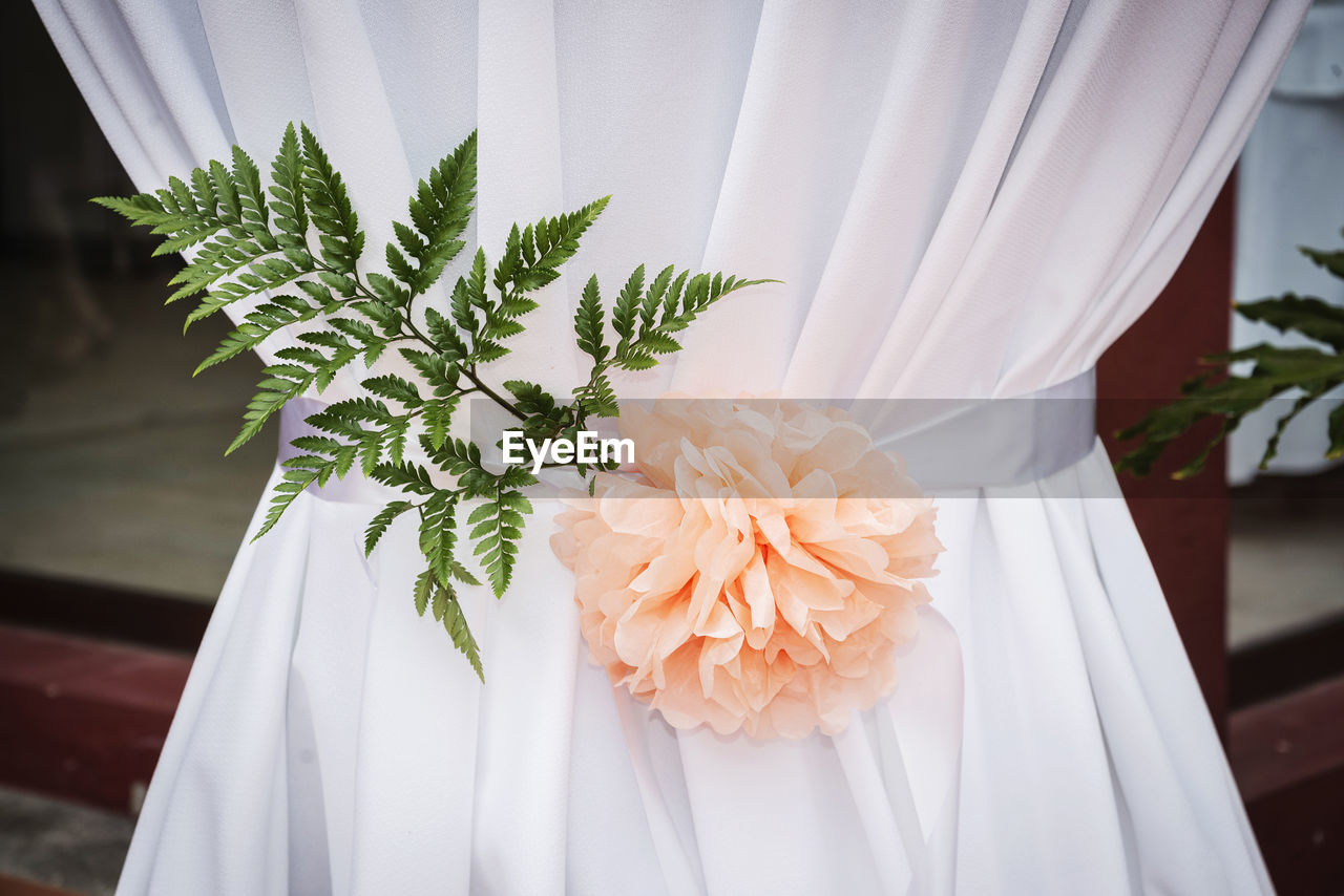 Close-Up Of Flower On Curtain At Wedding Ceremony