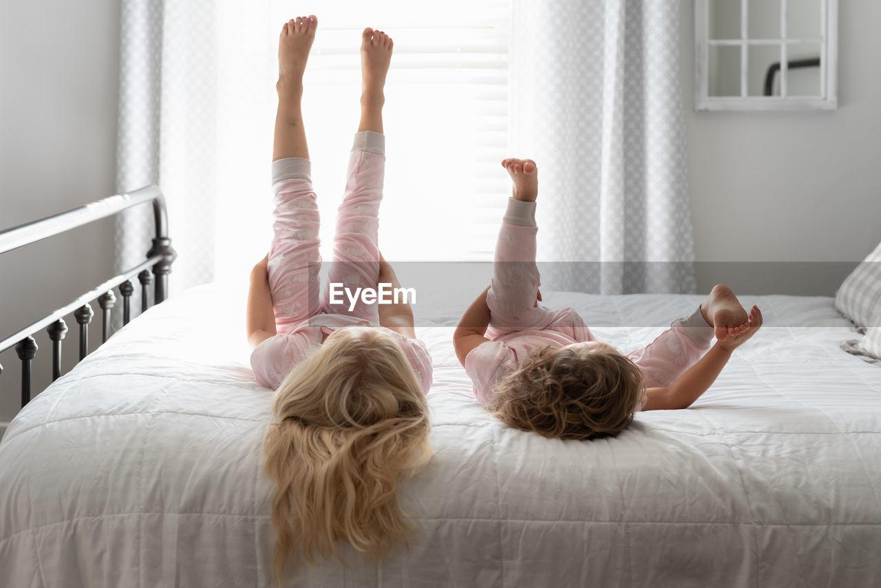 Girls lying on bed