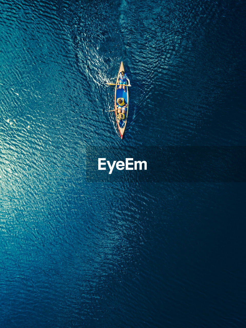 High Angle View Of People In A Canoe