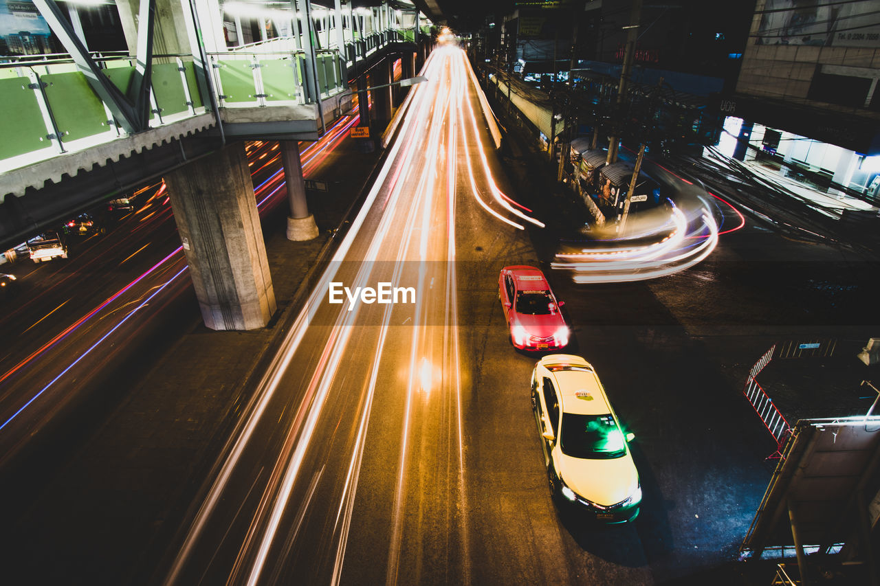 transportation, illuminated, mode of transportation, motion, long exposure, speed, city, blurred motion, road, architecture, light trail, no people, night, land vehicle, car, on the move, street, traffic, motor vehicle, built structure, outdoors, multiple lane highway