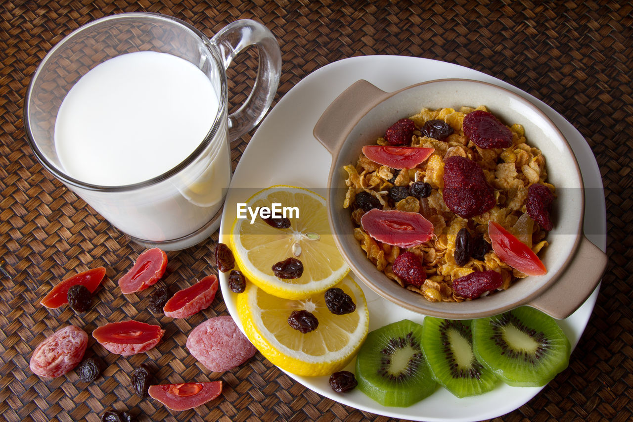 food and drink, food, healthy eating, freshness, wellbeing, table, high angle view, fruit, drink, still life, indoors, bowl, refreshment, no people, plate, meal, breakfast, ready-to-eat, close-up, milk, glass