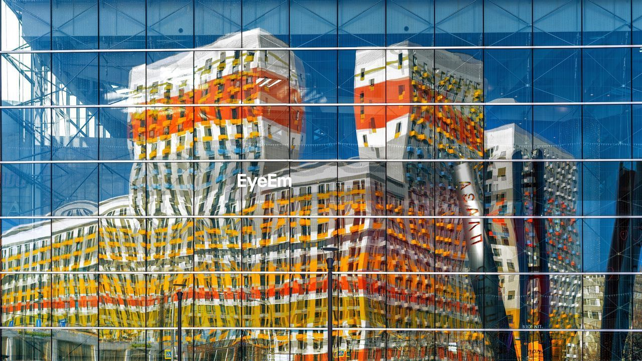 architecture, built structure, glass - material, building exterior, no people, window, reflection, building, day, pattern, outdoors, metal, modern, transparent, low angle view, full frame, city, multi colored, design, office building exterior