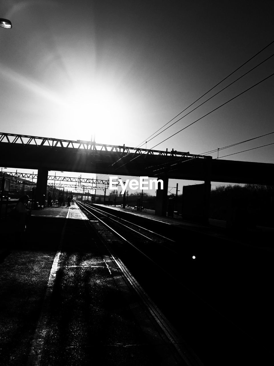 transportation, railroad track, rail transportation, cable, connection, sky, sun, no people, public transportation, built structure, outdoors, clear sky, day, architecture