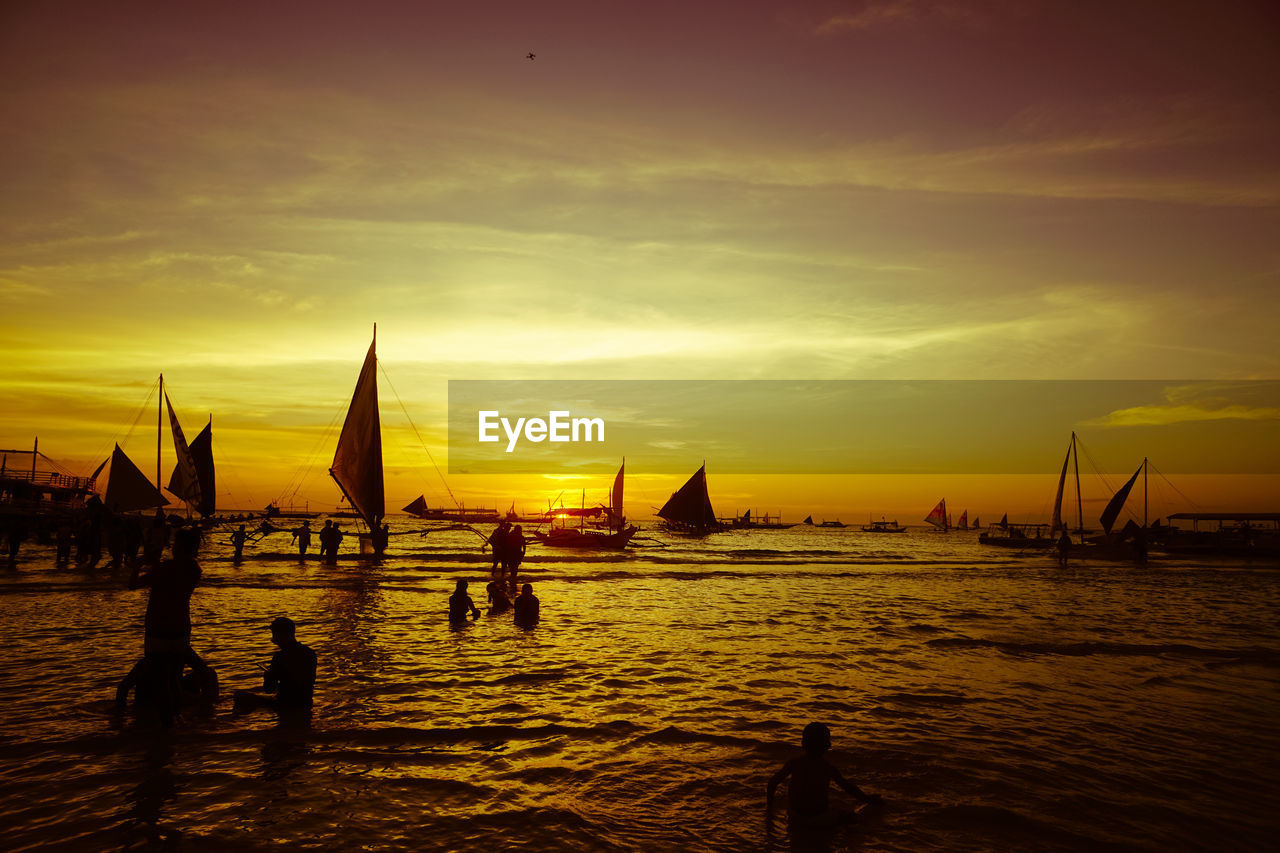 water, sunset, sky, nautical vessel, transportation, mode of transportation, sea, orange color, cloud - sky, silhouette, beauty in nature, nature, waterfront, scenics - nature, sailboat, outdoors, idyllic, travel, tranquil scene, wooden post
