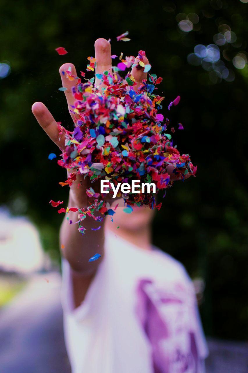 Close-Up Of Man With Multi Colored Confetti