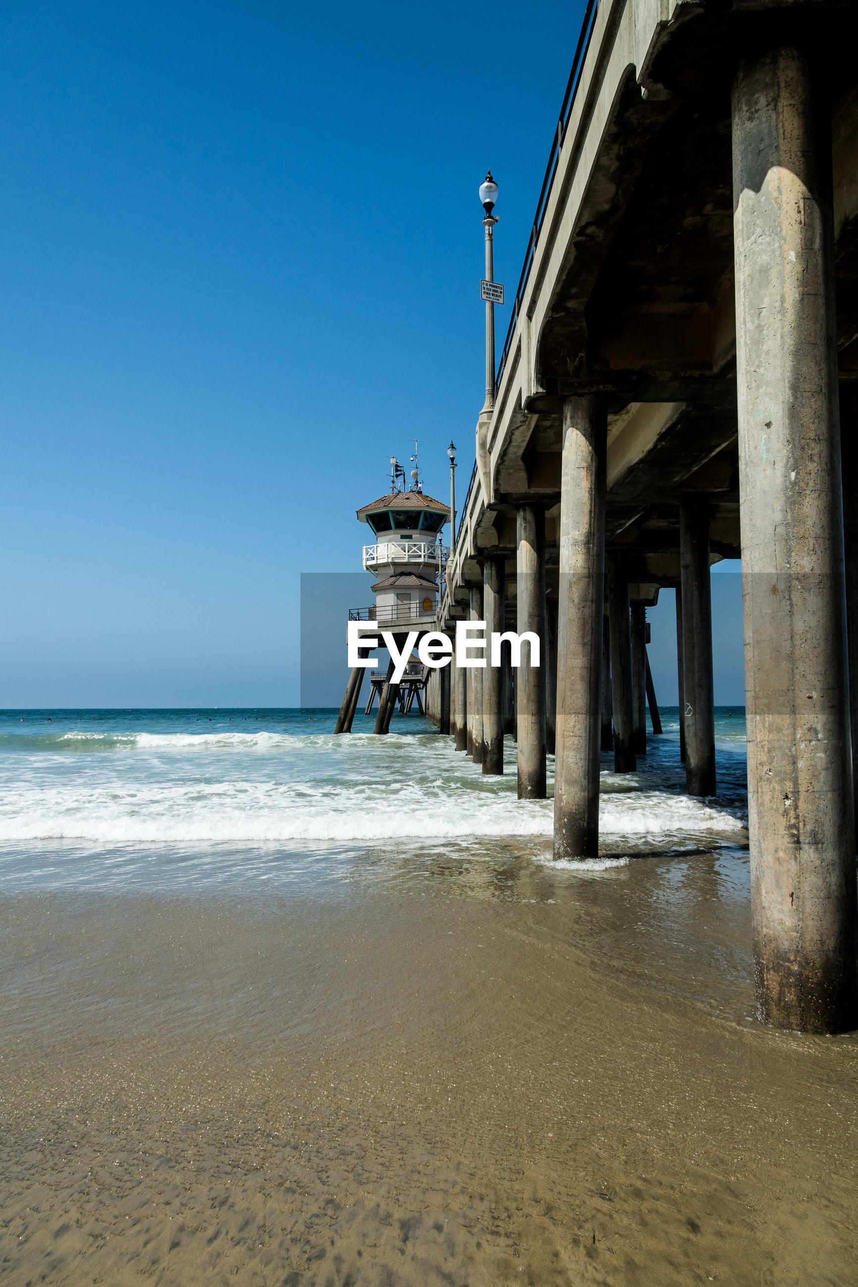 VIEW OF PIER ON BEACH AGAINST CLEAR SKY