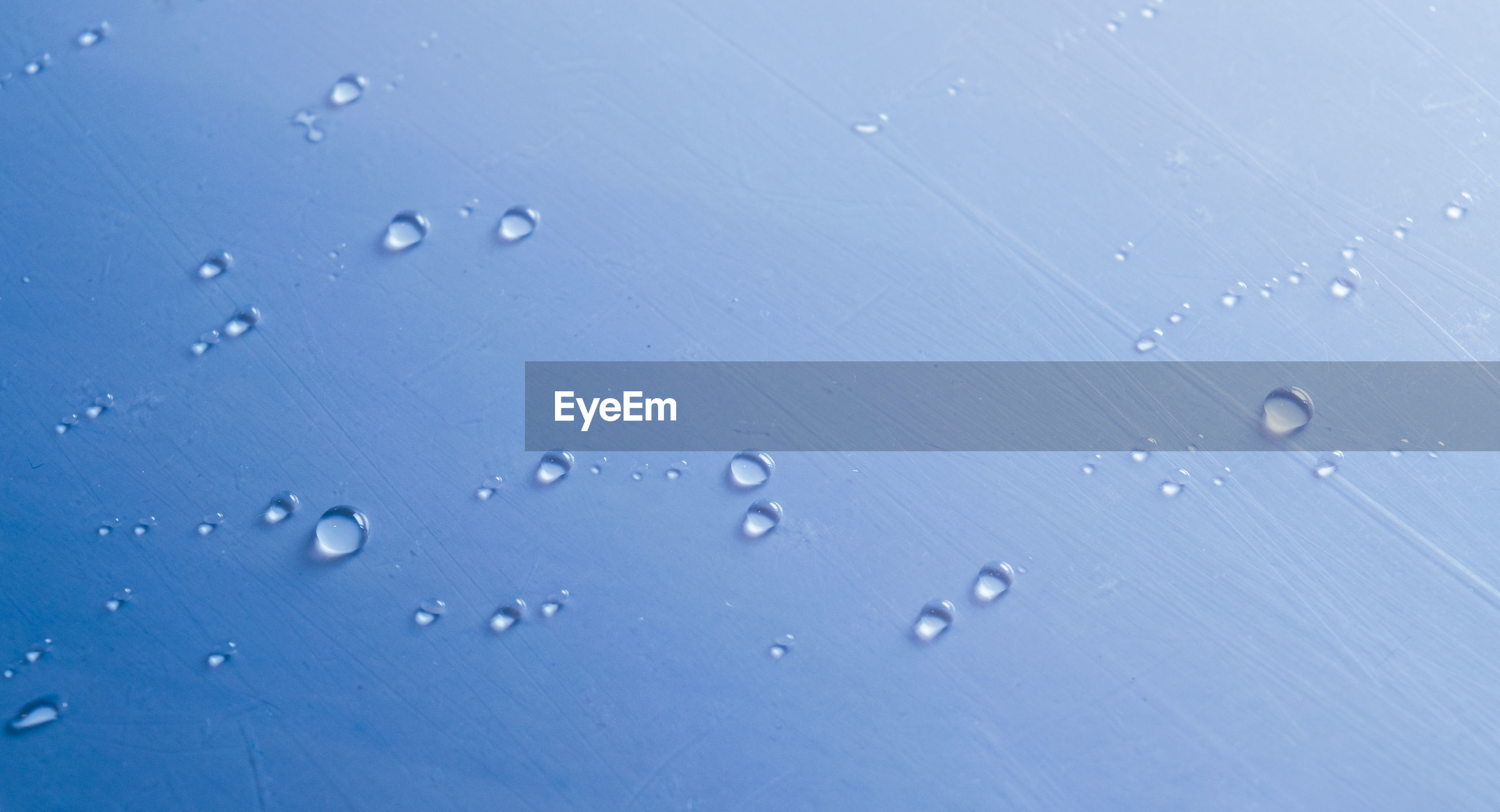 High angle view of water drops on table
