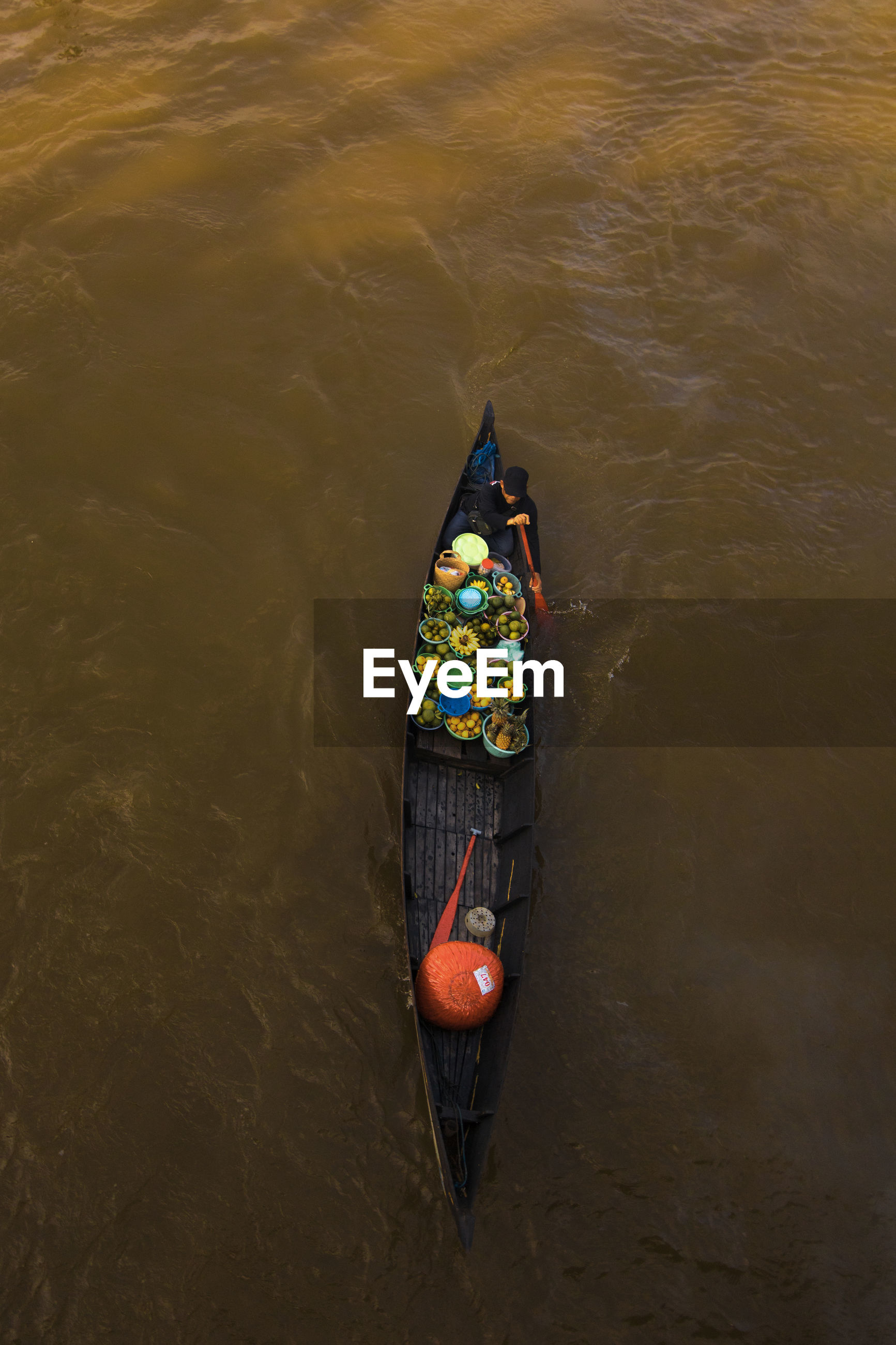 High angle view of man in boat on river