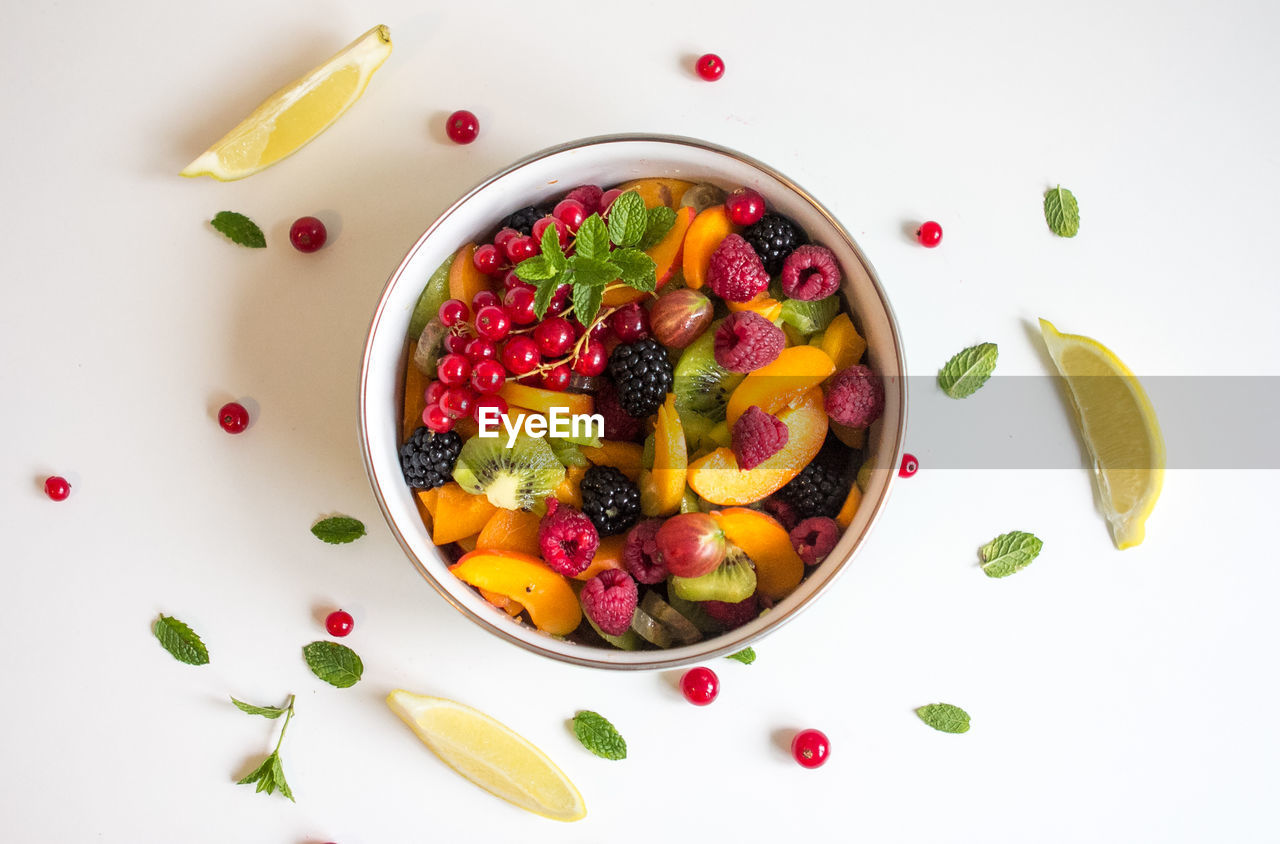 food and drink, food, healthy eating, fruit, wellbeing, berry fruit, freshness, strawberry, directly above, bowl, still life, ready-to-eat, indoors, white background, no people, high angle view, breakfast, kiwi, healthy lifestyle, seed, fruit salad