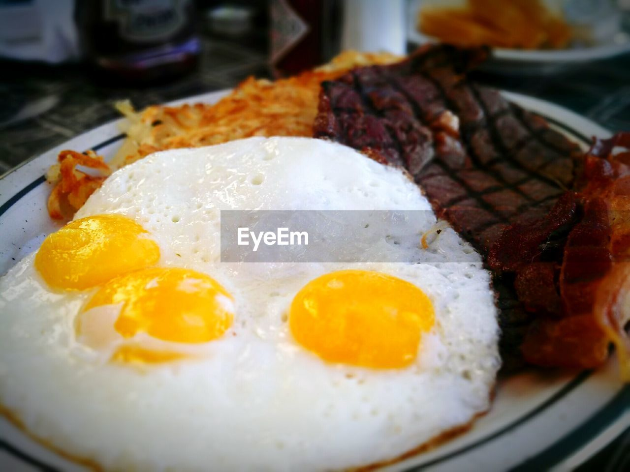 Detail shot of breakfast consisting of fried eggs