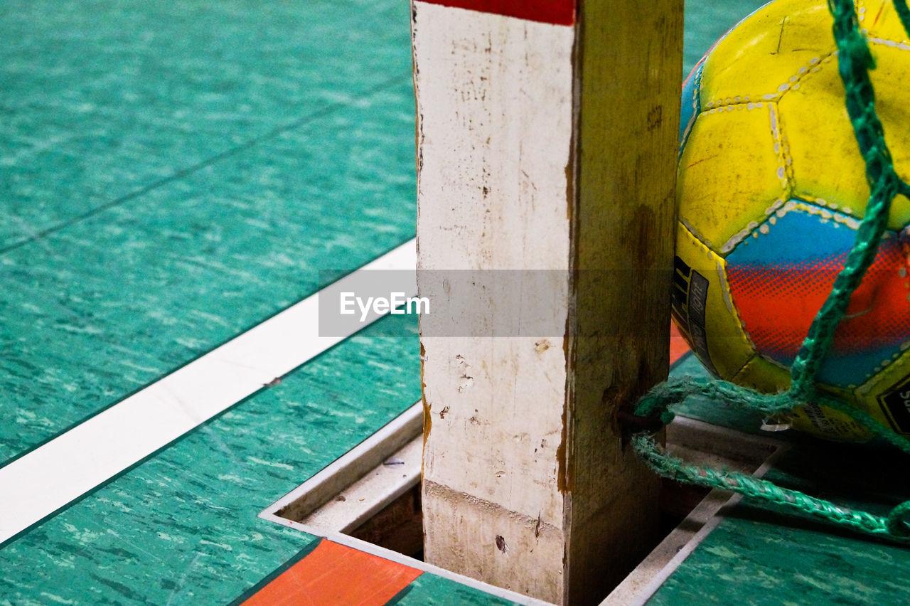 High angle view of ball on hardwood floor