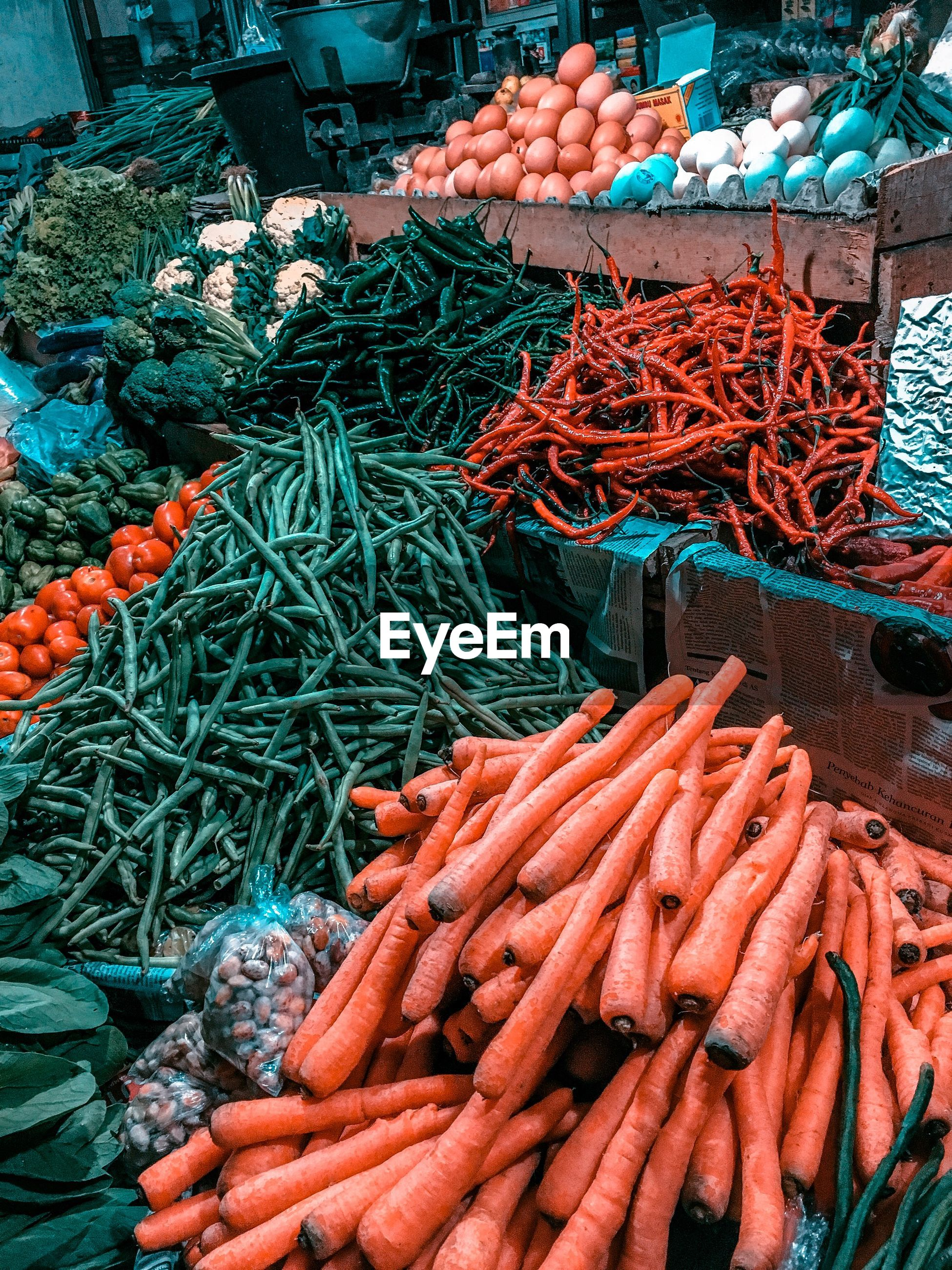High angle view of various vegetables for sale at market stall