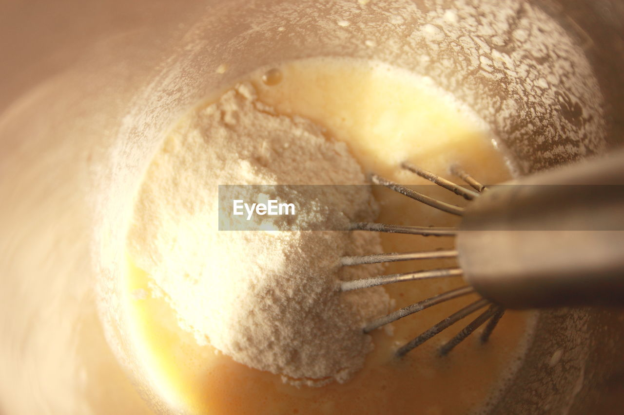 Close-up wire whisk in flour
