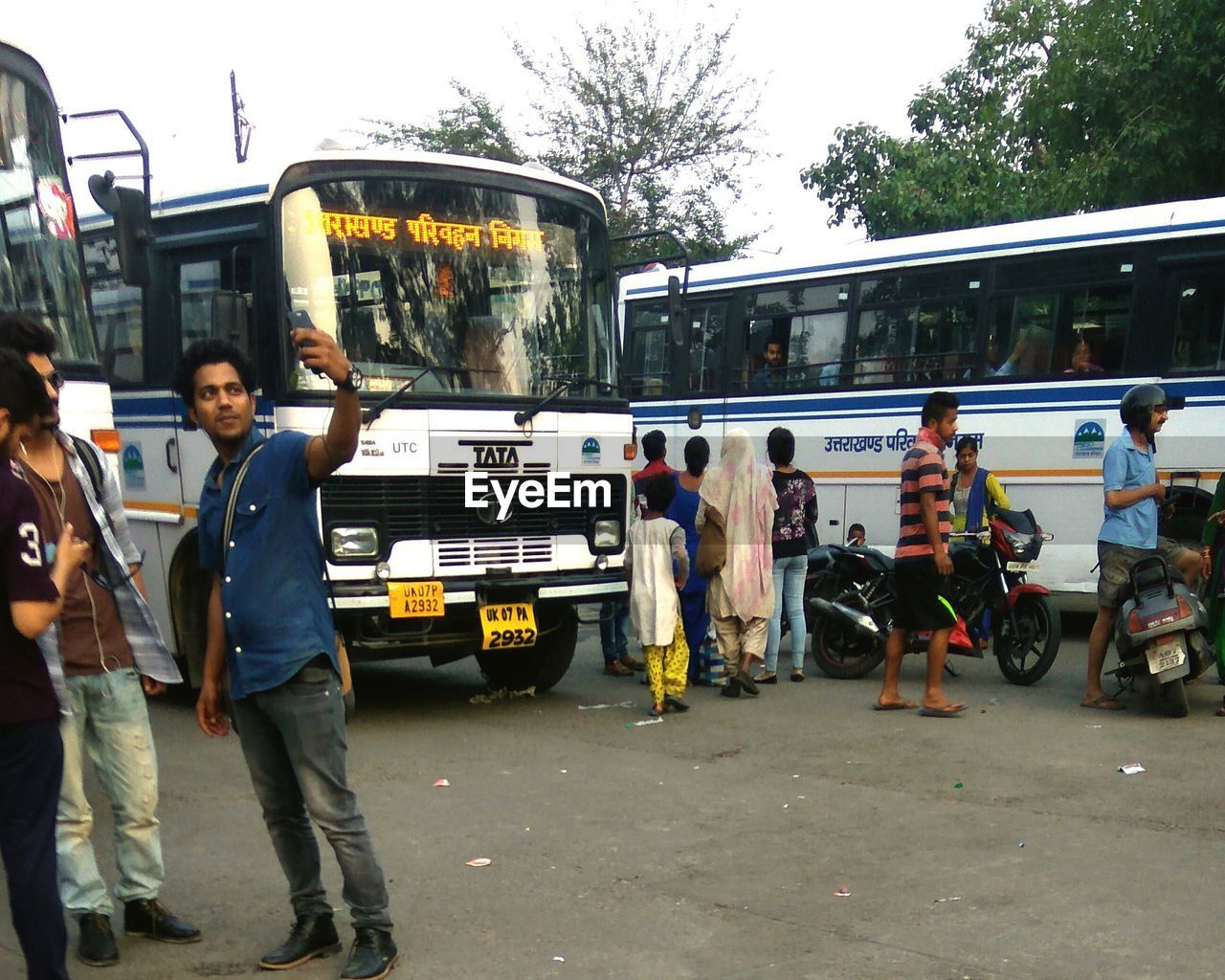 transportation, land vehicle, mode of transport, car, real people, public transportation, standing, stationary, day, full length, outdoors, men, togetherness, large group of people, young adult, people