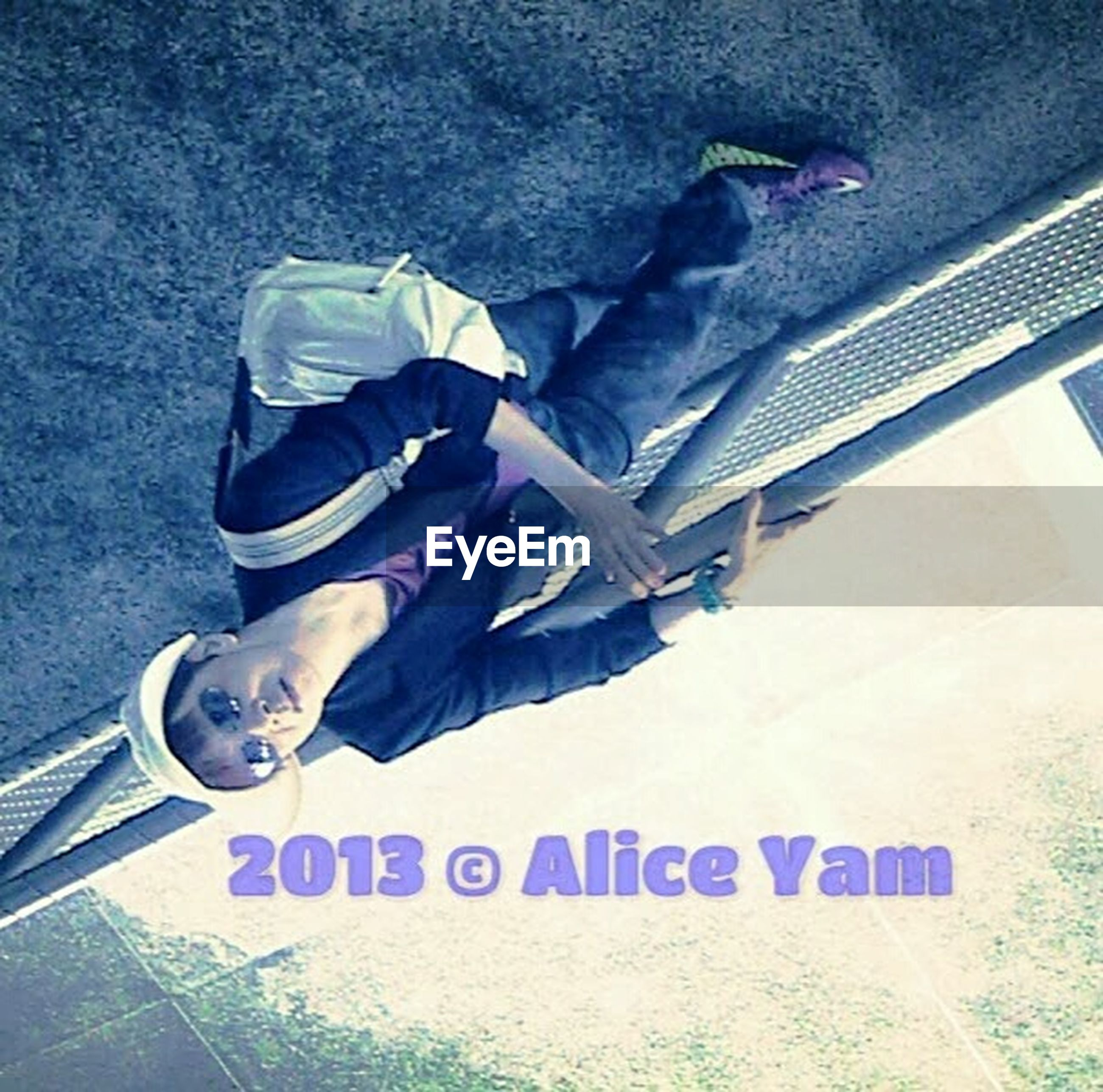 high angle view, text, communication, indoors, lifestyles, western script, leisure activity, part of, men, person, low section, day, holding, shoe, close-up, technology, standing