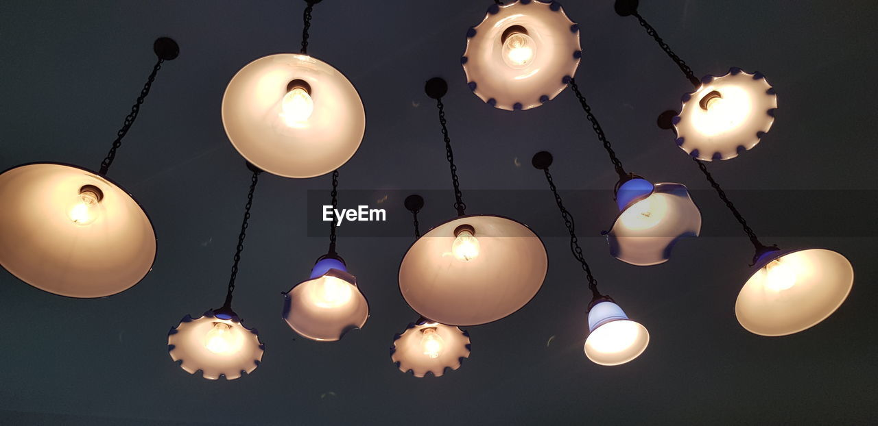 illuminated, lighting equipment, hanging, low angle view, decoration, no people, electricity, glowing, pendant light, ceiling, sky, indoors, celebration, light bulb, large group of objects, night, string, lantern, nature, light, directly below, paper lantern