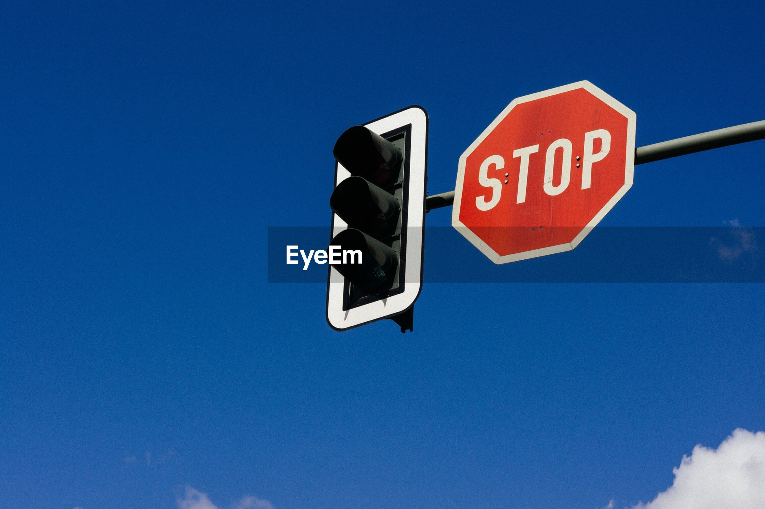 Stop road signal against blue sky