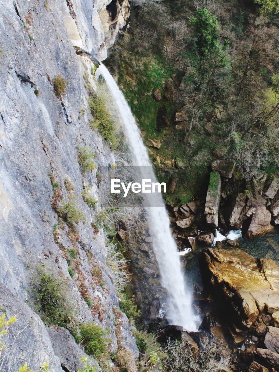 waterfall, motion, rock - object, nature, water, long exposure, rock formation, scenics, beauty in nature, outdoors, blurred motion, river, tourism, rapid, no people, travel, power in nature, cliff, day, travel destinations, mountain, forest, rock face, freshness