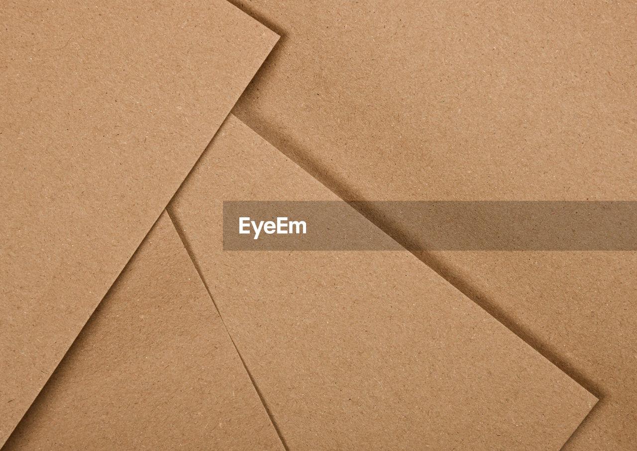 FULL FRAME SHOT OF PAPER BOX ON TILED FLOOR