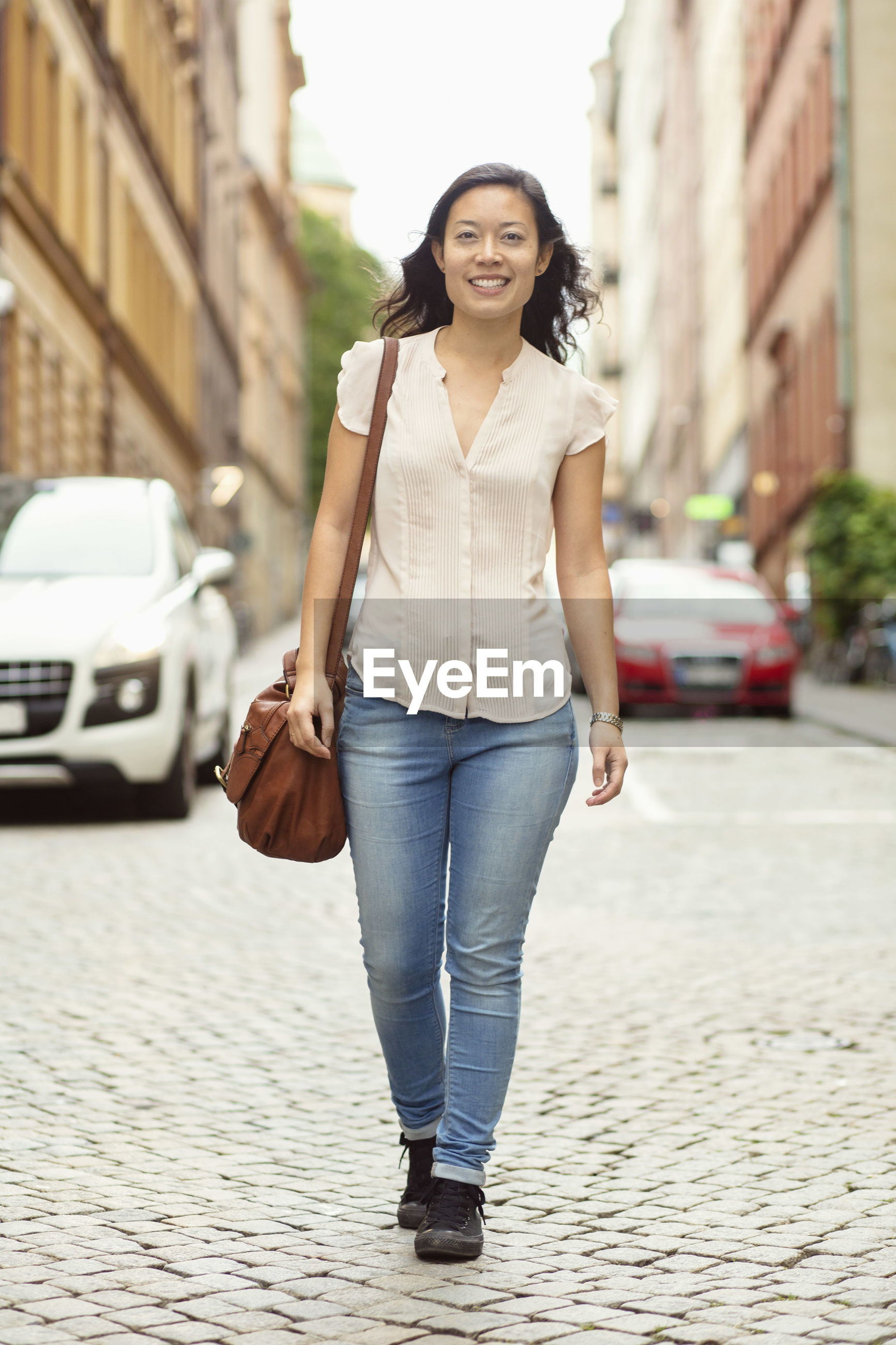 FULL LENGTH PORTRAIT OF YOUNG WOMAN STANDING ON STREET
