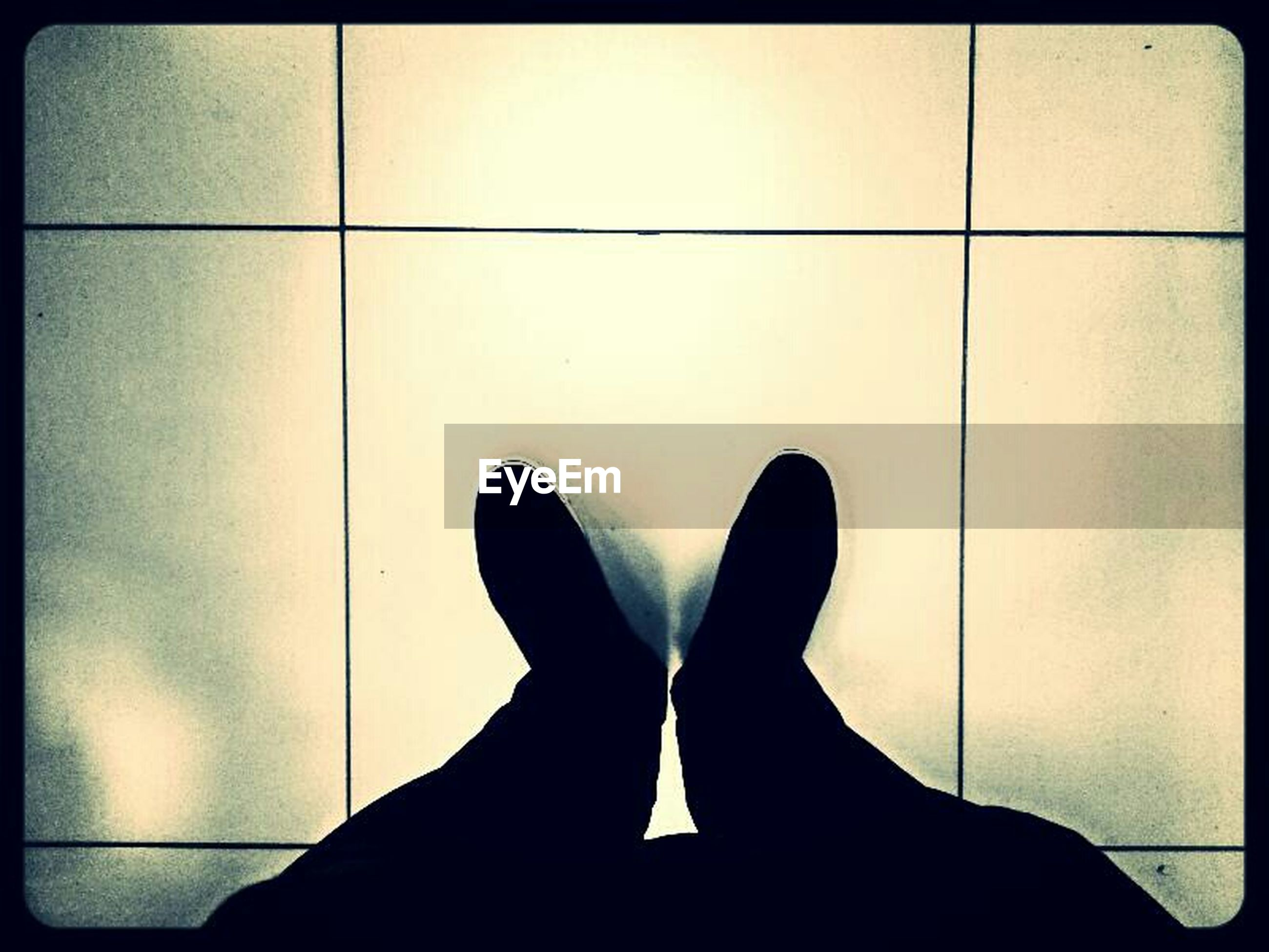 transfer print, low section, personal perspective, person, auto post production filter, shoe, indoors, standing, human foot, men, lifestyles, unrecognizable person, footwear, part of, leisure activity, wall - building feature, tiled floor