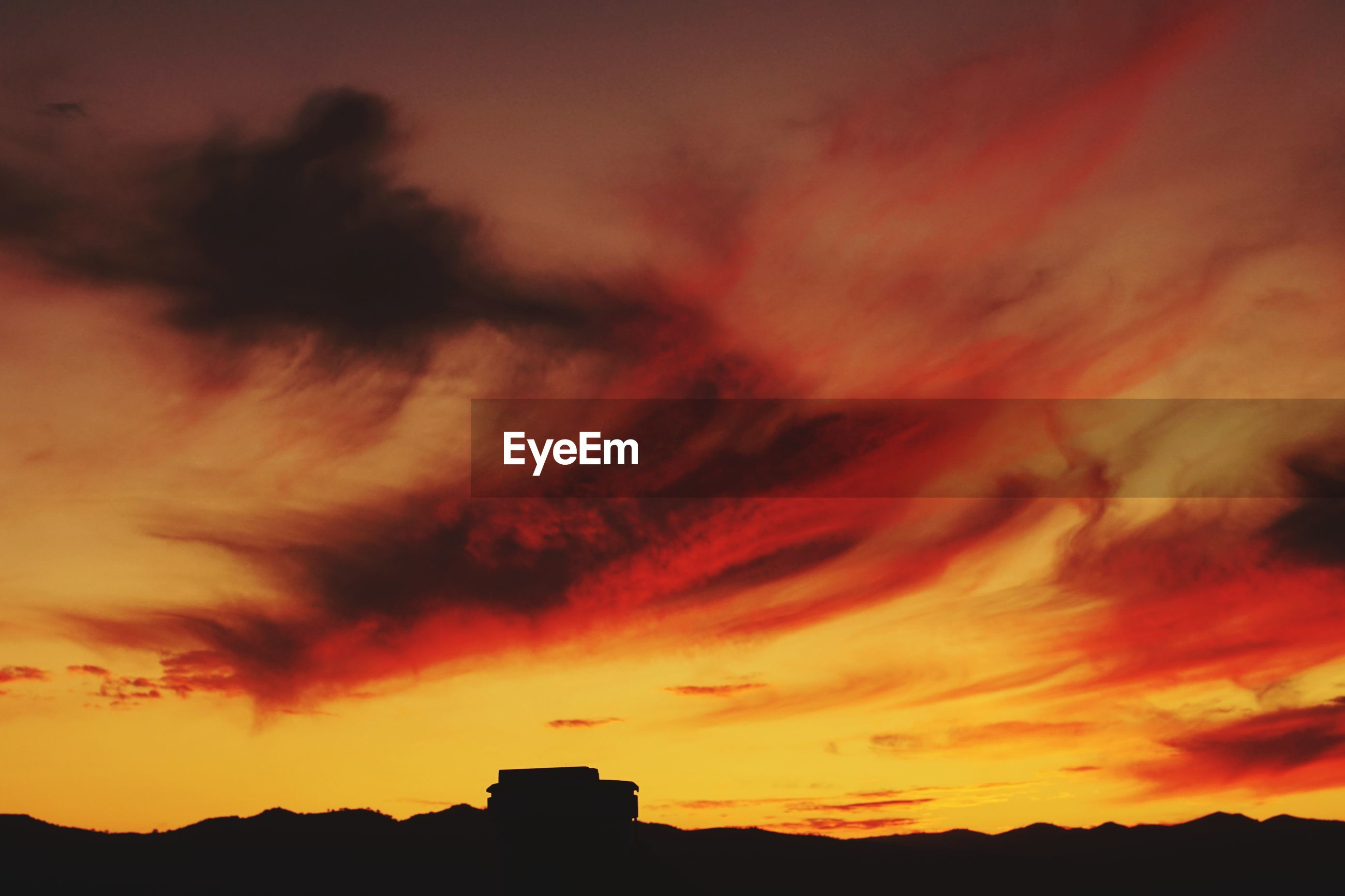 LOW ANGLE VIEW OF DRAMATIC SKY OVER SILHOUETTE LANDSCAPE