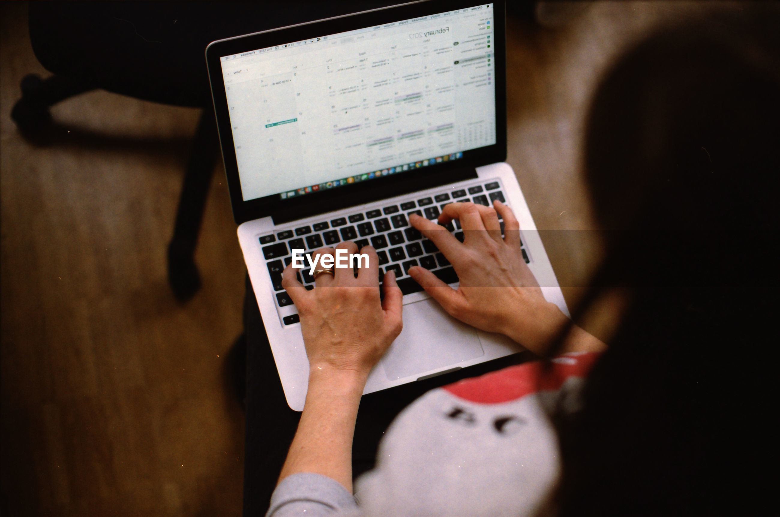 Close-up of woman using laptop at home