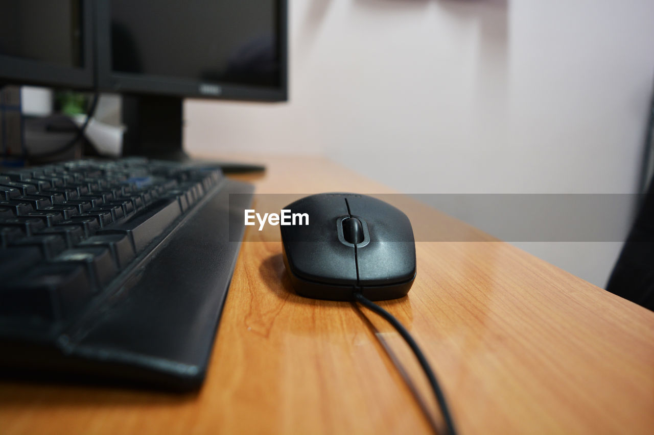 technology, computer, computer keyboard, desk, table, connection, indoors, desktop pc, computer mouse, communication, wireless technology, internet, no people, laptop, keyboard, computer monitor, office, wood - material, computer part, business, computer key, close-up, working, day