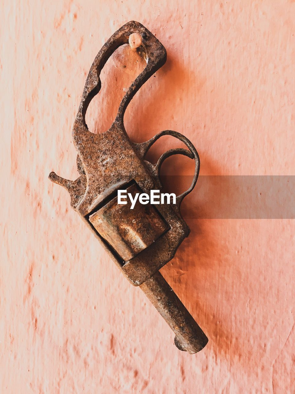 Close-up of rusty gun on wall