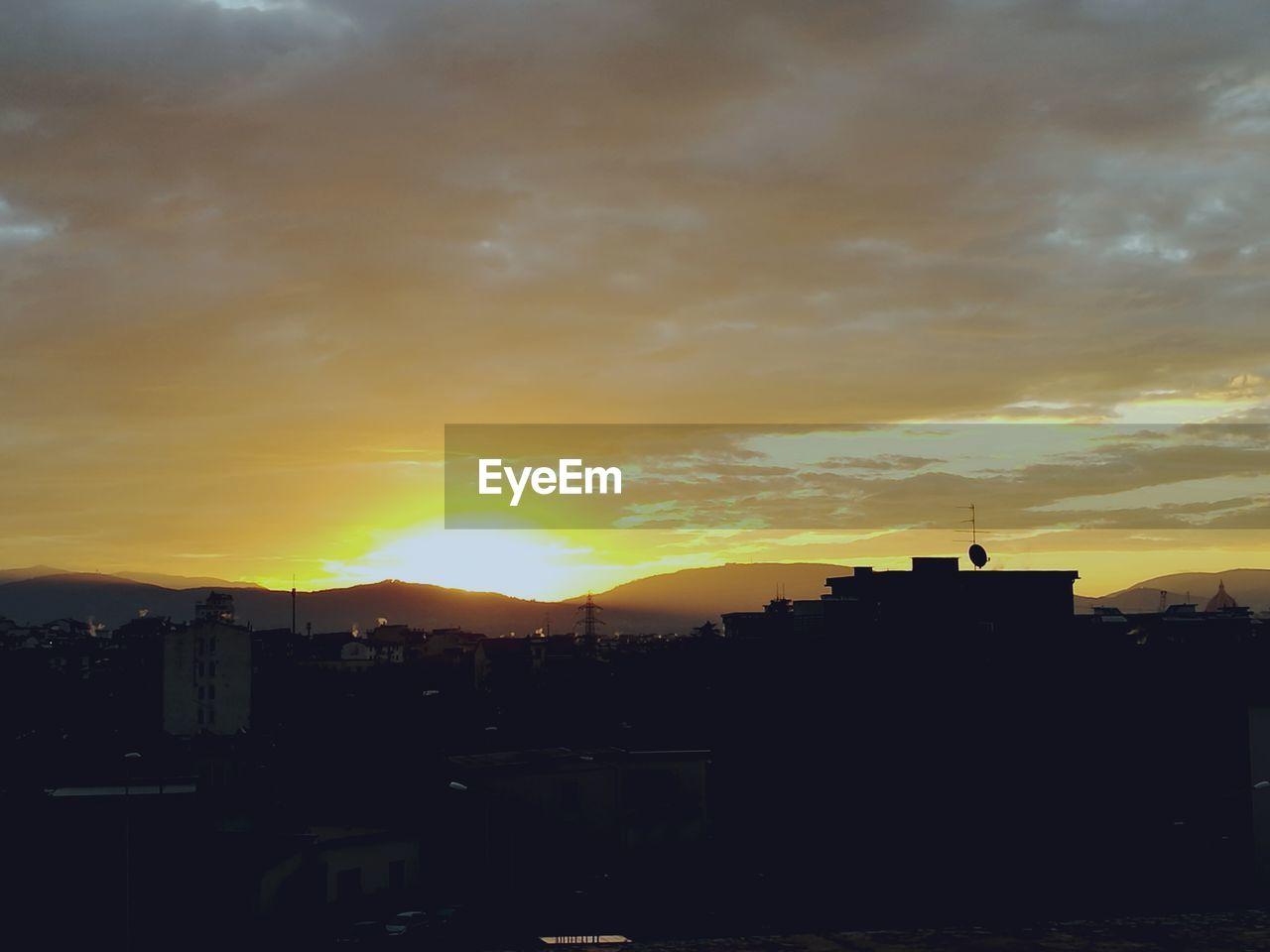 sunset, silhouette, architecture, building exterior, built structure, orange color, sky, city, no people, cityscape, cloud - sky, outdoors, travel destinations, skyscraper, nature, beauty in nature