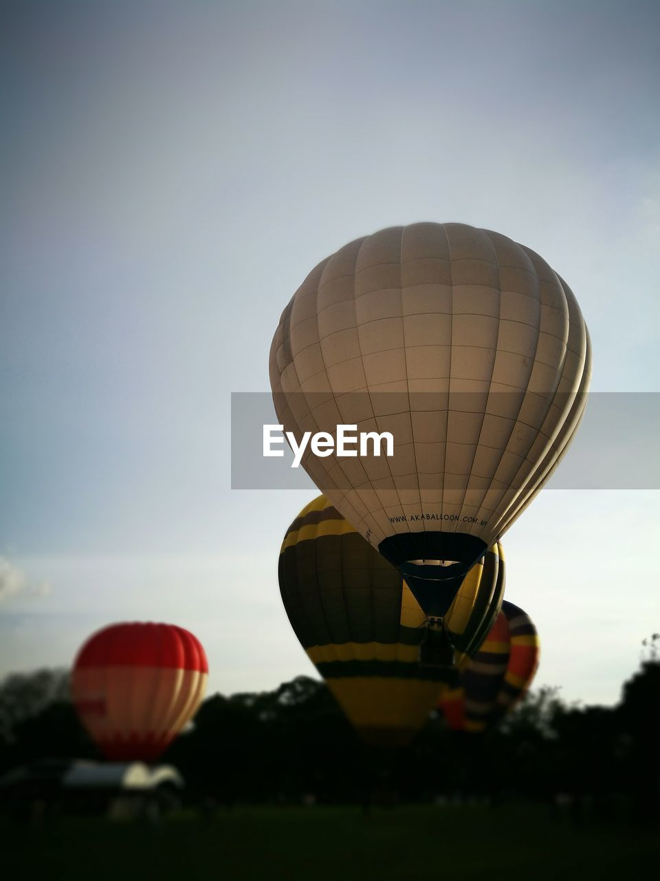 hot air balloon, ballooning festival, transportation, adventure, sky, mid-air, air vehicle, flying, outdoors, day, no people