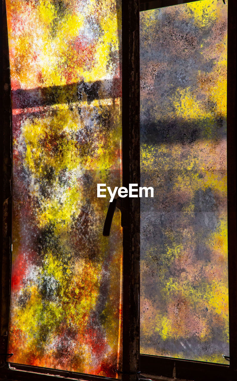 no people, close-up, metal, backgrounds, nature, full frame, day, indoors, window, door, architecture, pattern, textured, multi colored, entrance, wood - material, auto post production filter, yellow, glass - material, textured effect