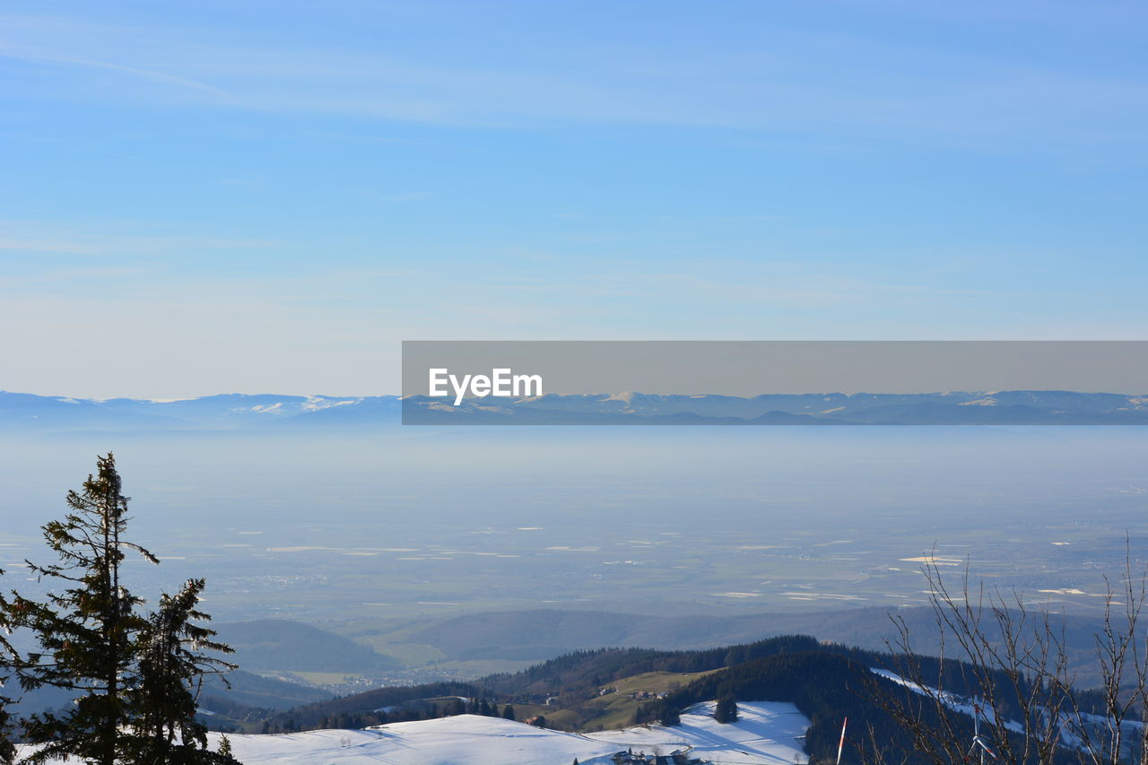 sky, beauty in nature, mountain, scenics - nature, winter, tranquility, tranquil scene, cold temperature, nature, tree, snow, plant, no people, cloud - sky, day, environment, mountain range, non-urban scene, outdoors, snowcapped mountain