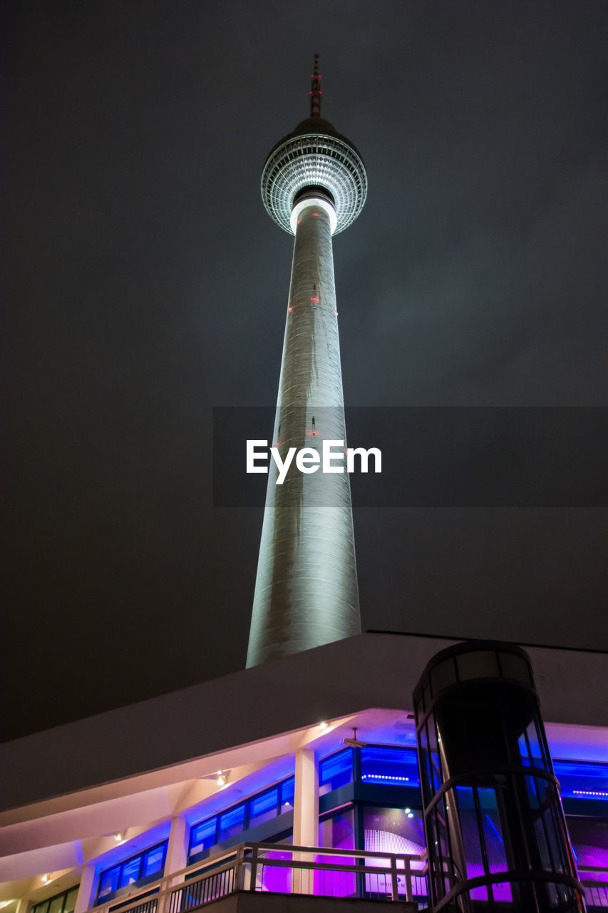 architecture, built structure, tall - high, low angle view, building exterior, tower, illuminated, travel destinations, modern, night, city, television tower, communication, no people, skyscraper, sky, outdoors