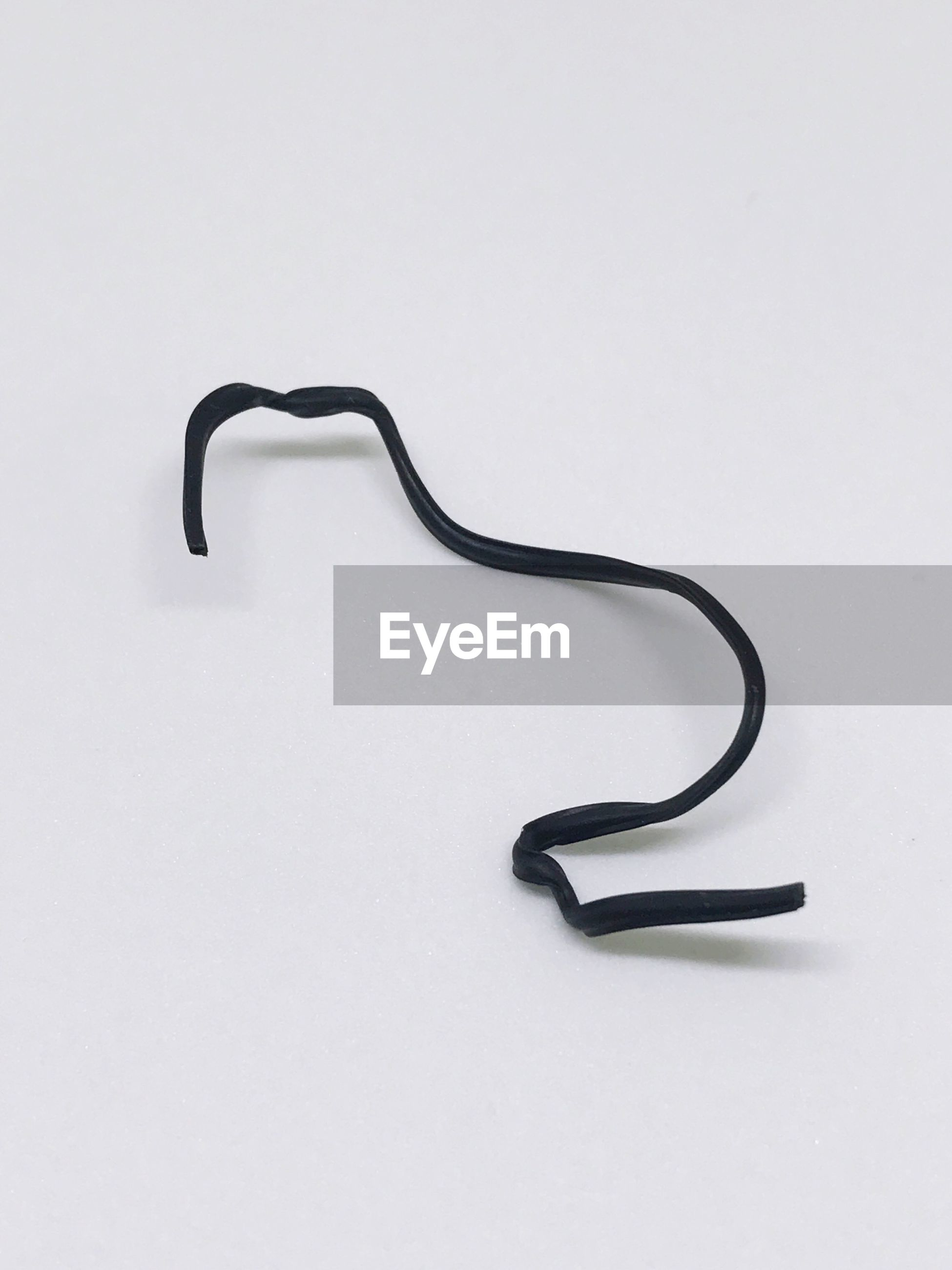 High angle view of black strap on white background