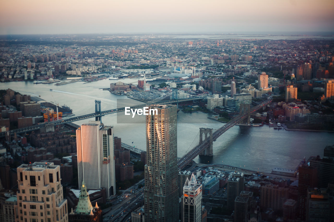 building exterior, city, architecture, cityscape, built structure, building, sky, high angle view, nature, crowded, river, bridge, crowd, water, office building exterior, residential district, bridge - man made structure, skyscraper, outdoors, financial district