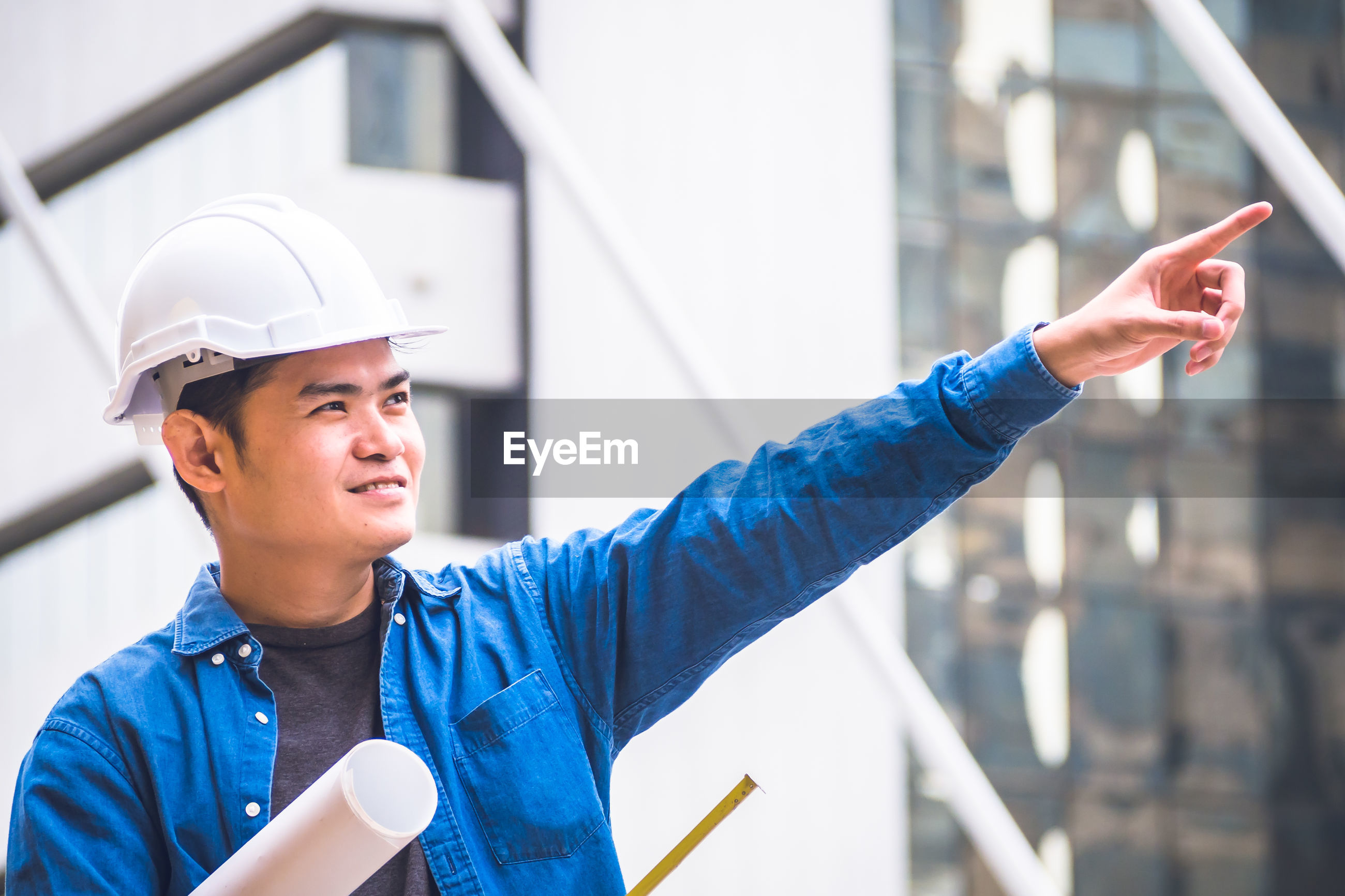 Engineer pointing while standing outdoors