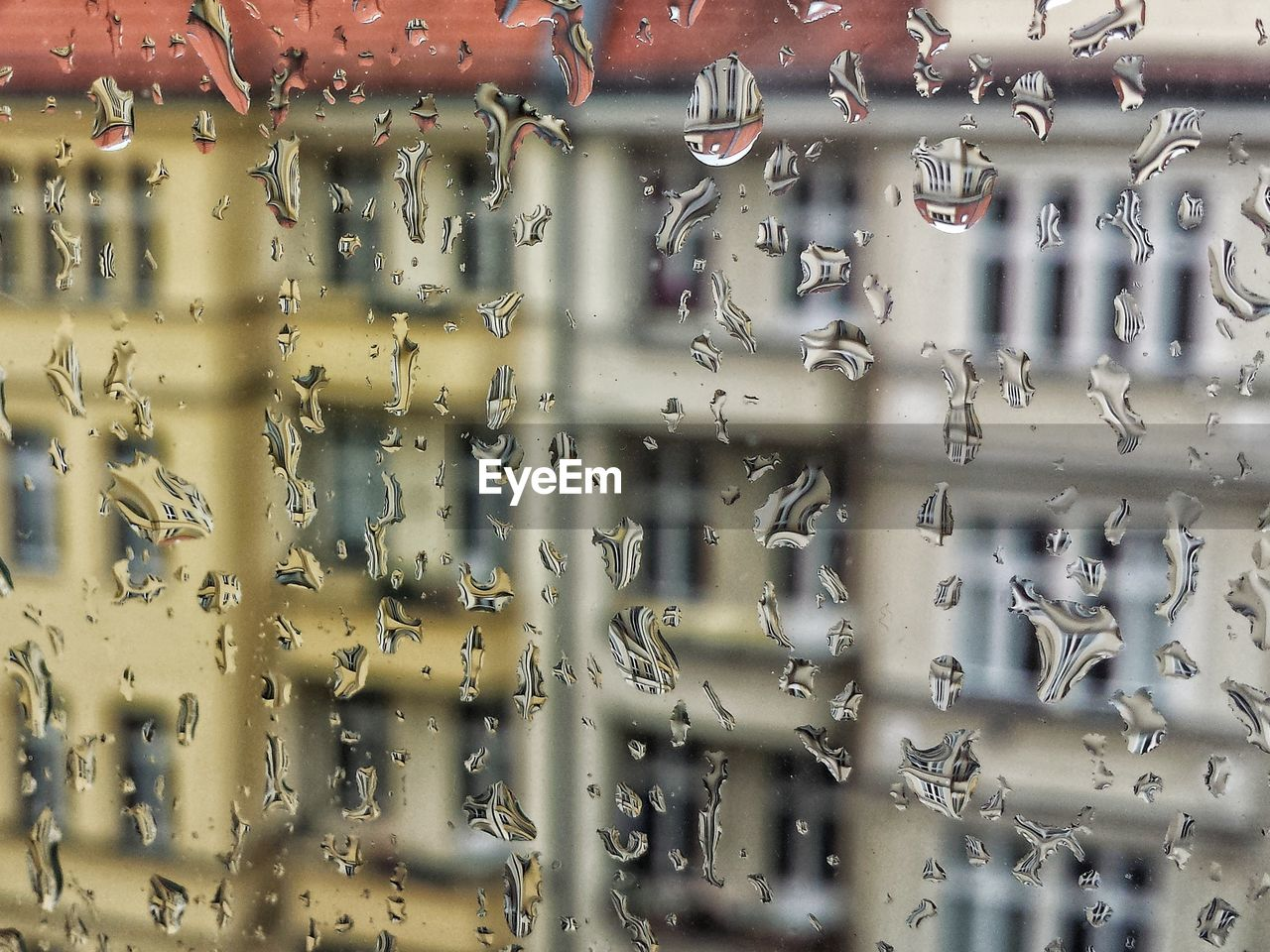 full frame, backgrounds, glass - material, no people, drop, water, close-up, wet, window, day, indoors, rain, transportation, mode of transportation, architecture, focus on foreground, pattern, transparent, rainy season, raindrop