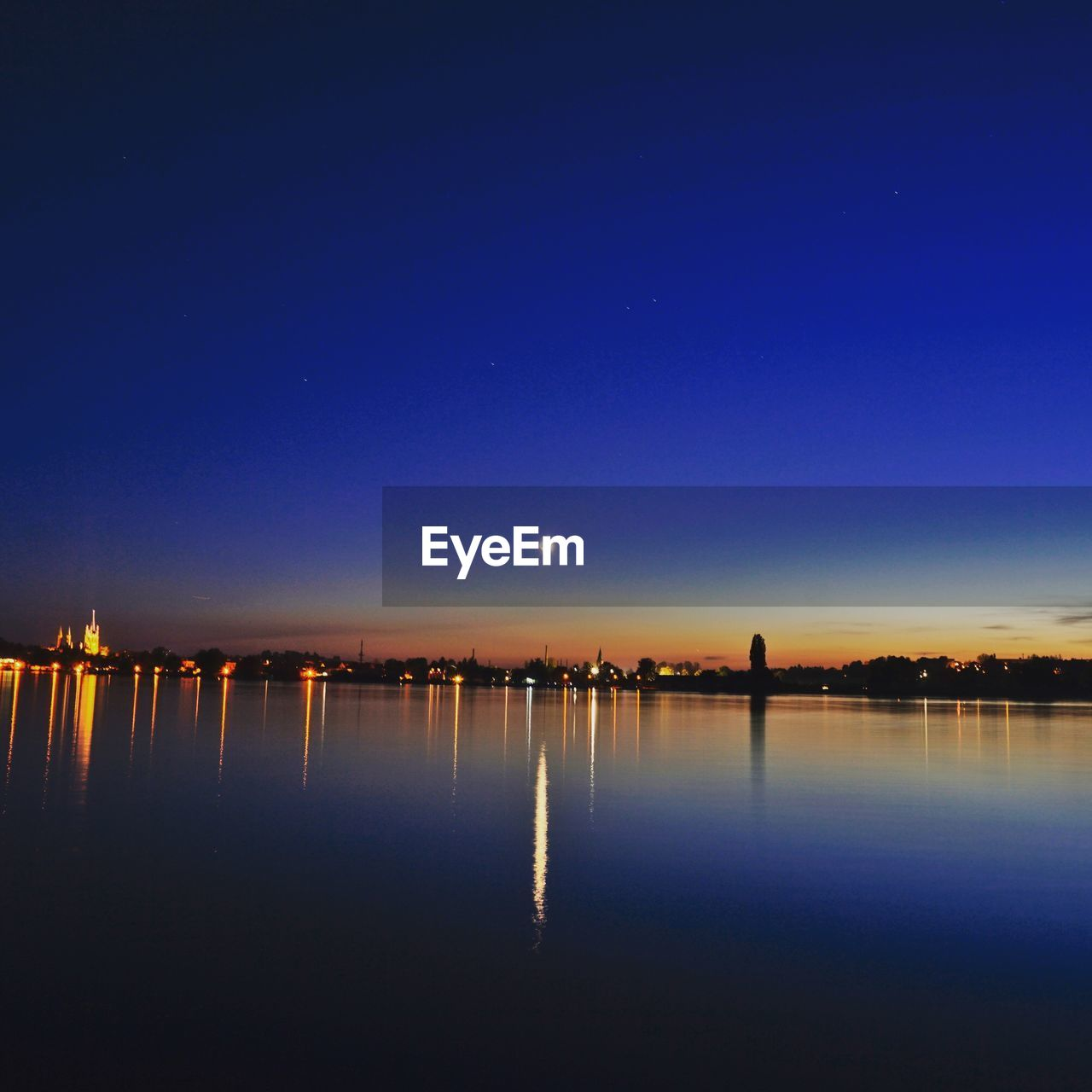 sky, water, reflection, scenics - nature, blue, beauty in nature, nature, no people, copy space, waterfront, night, illuminated, tranquility, tranquil scene, lake, clear sky, moon, outdoors, dusk