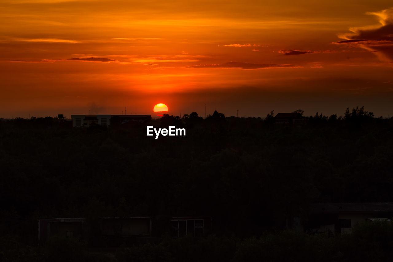 sunset, orange color, silhouette, built structure, sky, nature, beauty in nature, sun, scenics, architecture, no people, tree, cloud - sky, tranquility, building exterior, outdoors, landscape