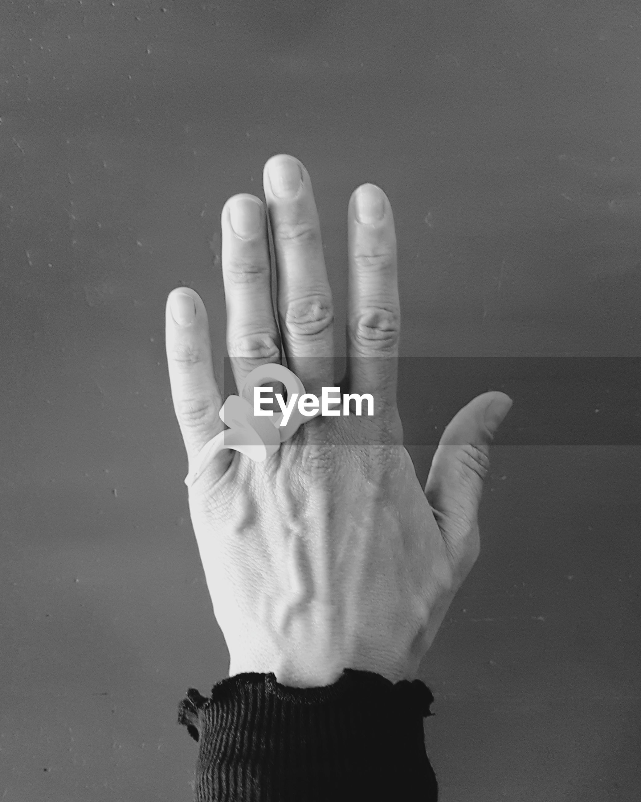 Close-up of hand against black background