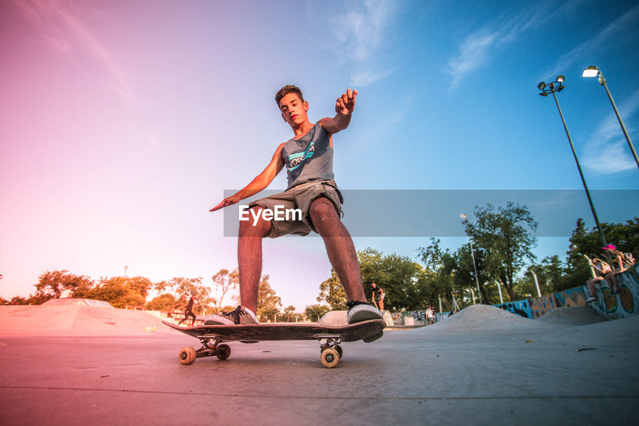 Low Angle View Of Man Skateboarding Against Sky