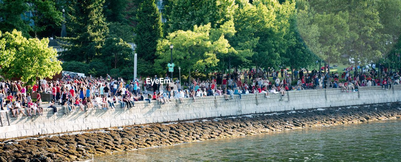 large group of people, real people, men, tree, outdoors, uniform, leisure activity, water, day, lifestyles, crowd, nature, people, adult, adults only