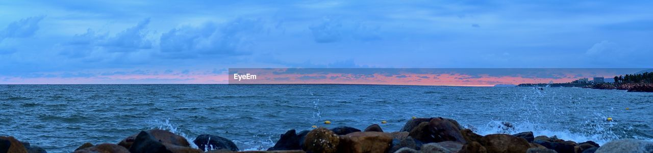 water, sky, sea, scenics - nature, cloud - sky, beauty in nature, nature, rock, tranquil scene, tranquility, horizon over water, solid, non-urban scene, panoramic, beach, no people, land, idyllic, horizon, outdoors