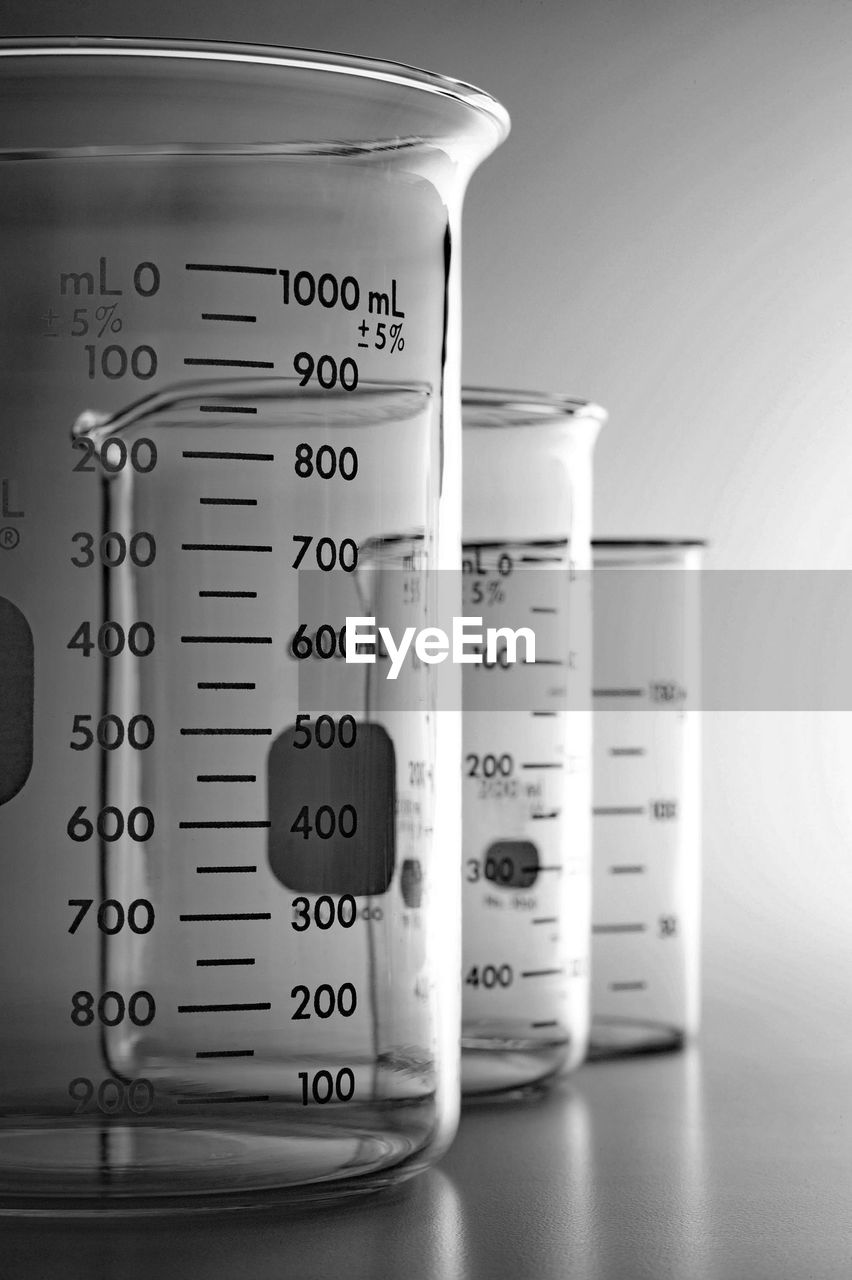 Measuring beakers on table in laboratory
