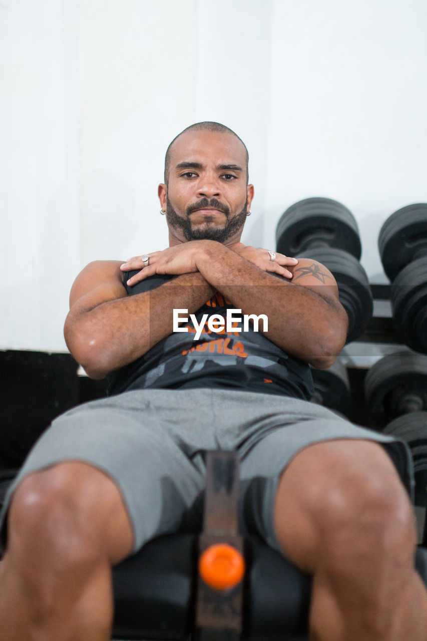 Portrait Of Man Exercising In Gym