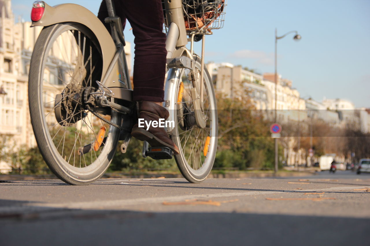 transportation, bicycle, city, road, mode of transportation, street, real people, land vehicle, lifestyles, low section, one person, men, day, riding, ride, sport, cycling, activity, human leg, outdoors, wheel